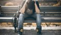 man-in-black-shirt-and-gray-denim-pants-sitting-on-gray-1134204 (1)